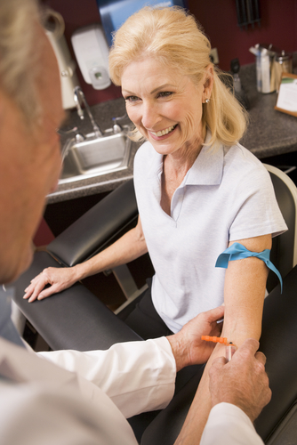 Image of doctor taking blood test